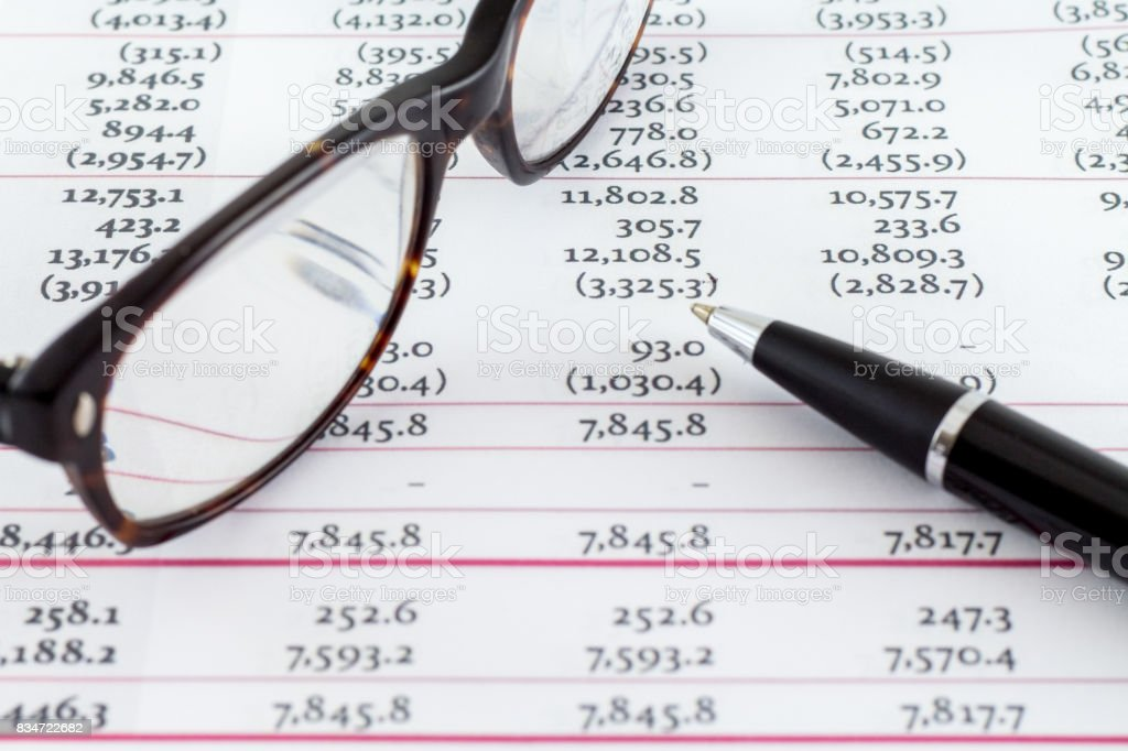 accounting financial banking account spreadsheet data with glasses