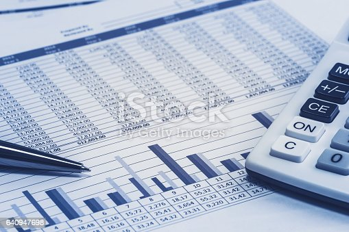 istock Accounting financial banking banker bank stock spreadsheet data with pen and calculator in blue analysis analyzer calculations 640947698