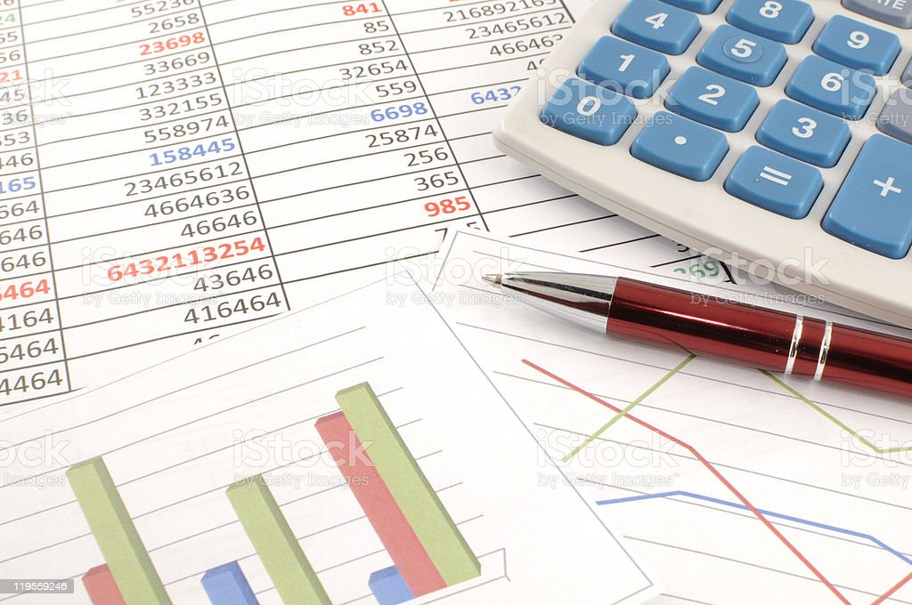 Accounting flat lay with paperwork tables, pen & calculator stock photo