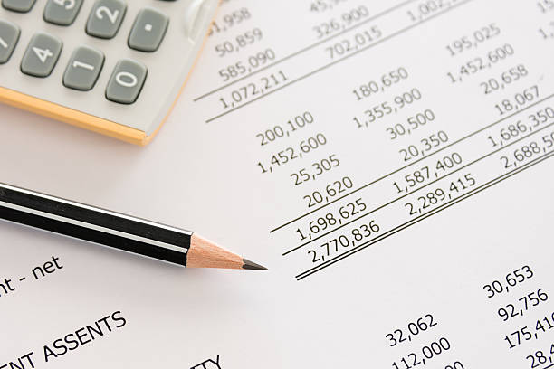 accounting Balance sheet ,pencil, calculator on accountant's desk. Accounting , accounts concept. accounting ledger stock pictures, royalty-free photos & images
