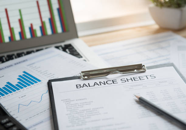 accounting reporting accounting concept. balance sheet and business earning report on desk. bank statement stock pictures, royalty-free photos & images