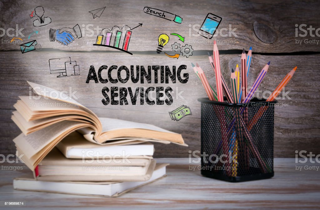 Accounting Services, Business Concept. Stack of books and pencil stock photo