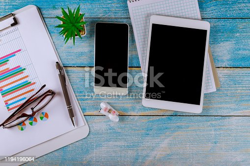 1060760900istockphoto Accounting showing business and financial report glasses with wireless headphone and digital tablet 1194196064