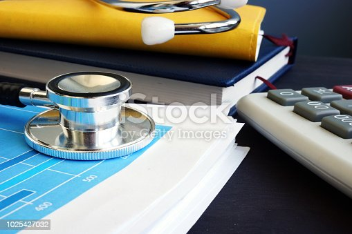 Accounting. Stethoscope and financial report with statistics. Analytic research.