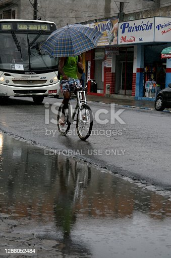 eunapolis, bahia / brazil - june 3, 2008: puddle of water accumulated due to rain in the city of Eunapolis, in the south of Bahia.