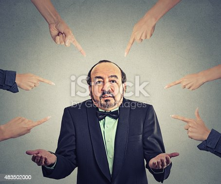 istock accusation of guilty arrogant businessman who shrugs shoulders 483502000