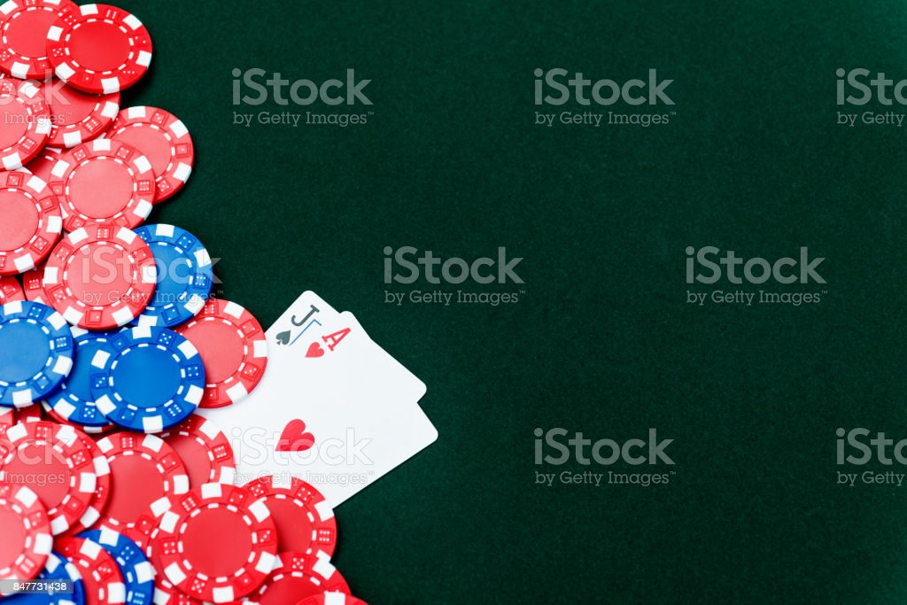 Ace and jack with poker chips stock photo