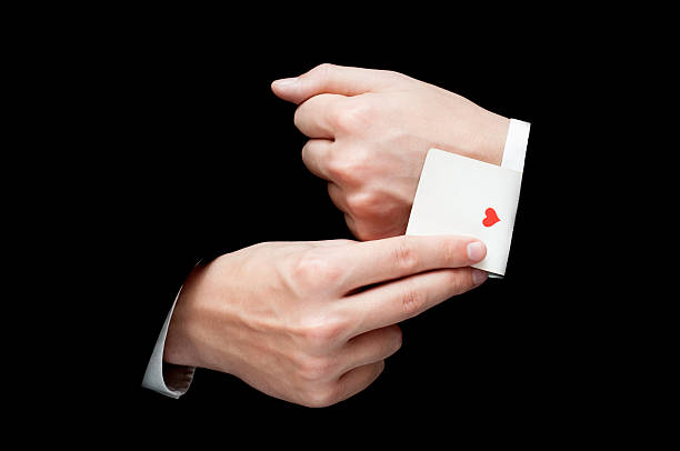 ace card hidden under sleeve - magician stock photos and pictures