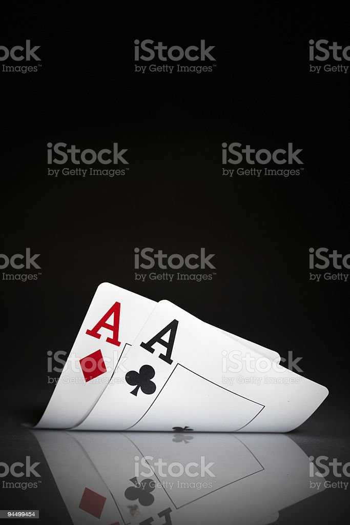 Ace of diamonds and clubs against black background stock photo