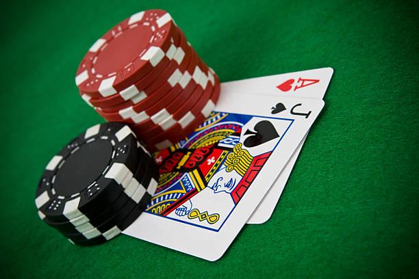 ace of hearts and black jack with poker chips - black jack bildbanksfoton och bilder