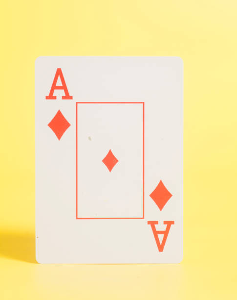 Ace of hearts on yellow background – zdjęcie