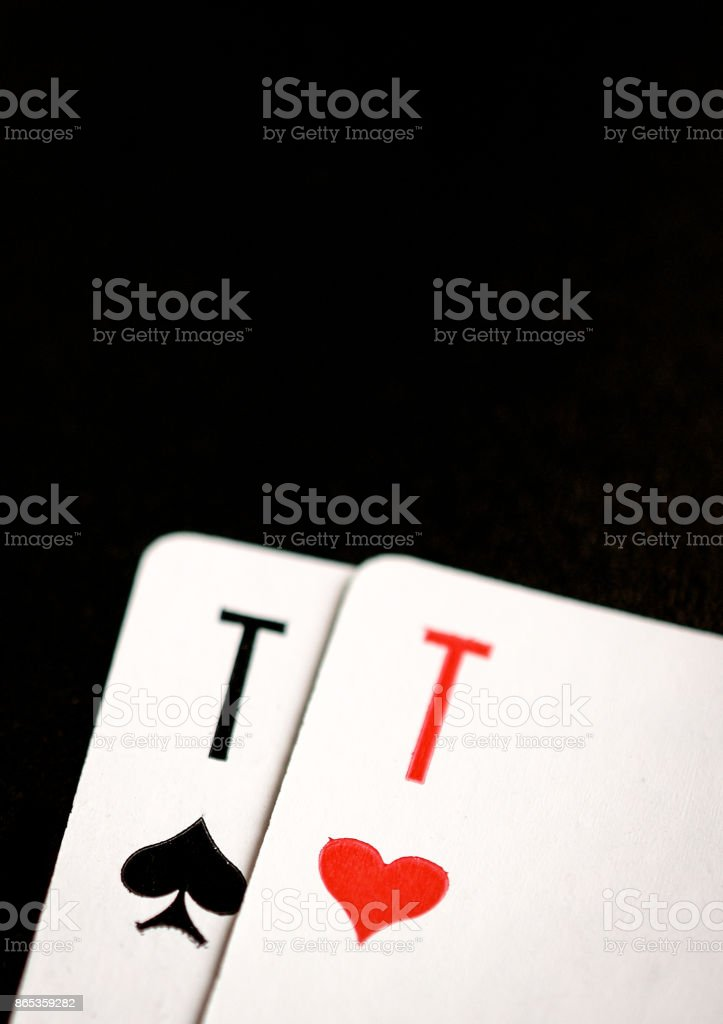 Ace of spades and ace of hearts on a black background – zdjęcie
