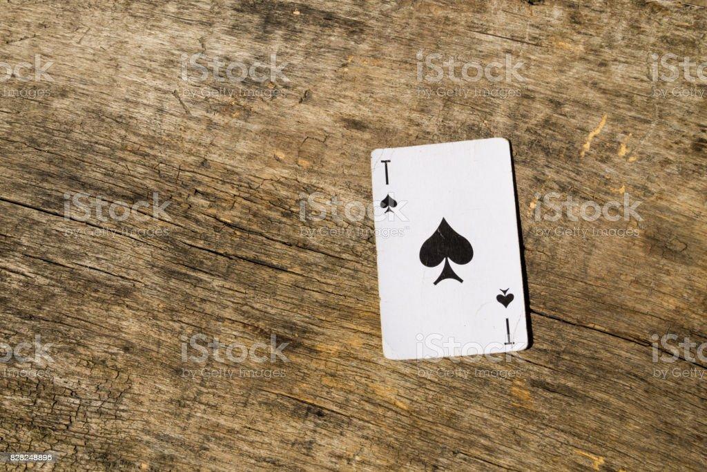 Ace of spades on old wooden background – zdjęcie