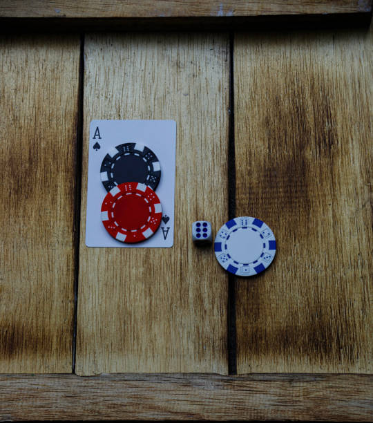Ace of spades poker chips and dice stock photo