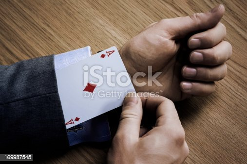 Businessman with an ace in his sleeve