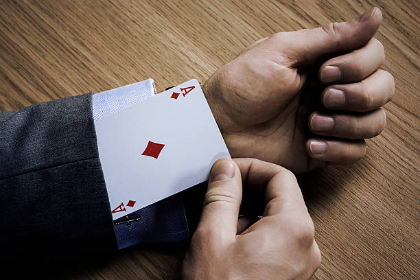 Ace Businessman with an ace in his sleeve magic trick stock pictures, royalty-free photos & images