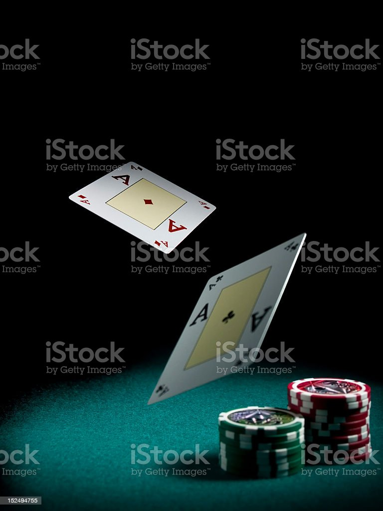 Ace playing cars falling onto chips royalty-free stock photo