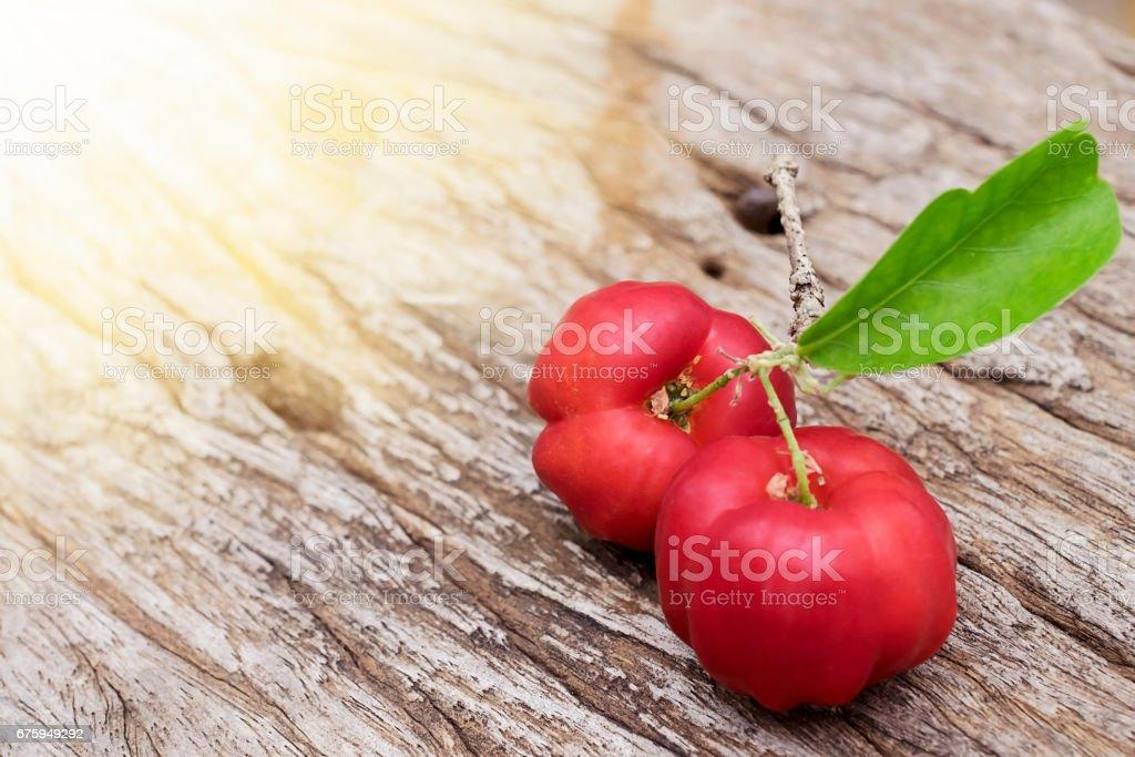 Acerola fruit on wood background stock photo