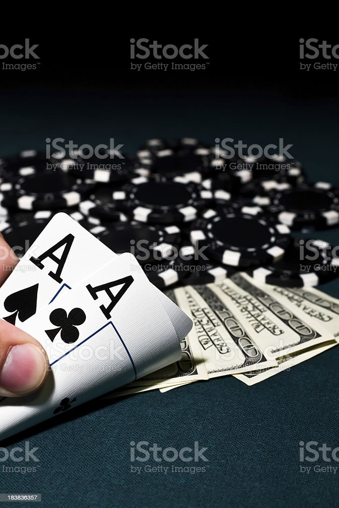 Aces, Poker Chips and Cash royalty-free stock photo
