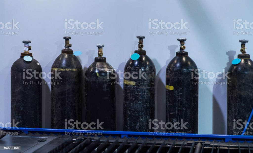 Acetylene and gas steel storage tanks for welding stock photo