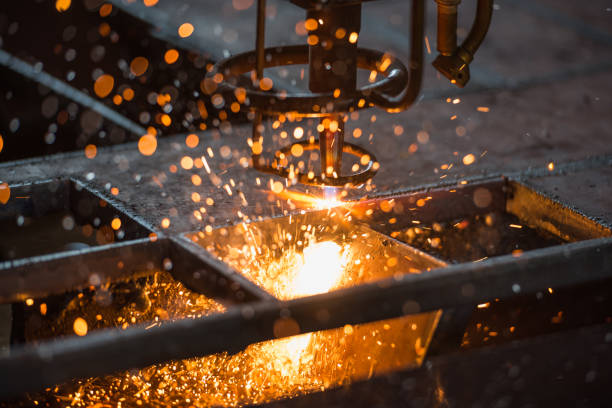 acetylene torch cnc auto machine cutting steel plate metalwork  with bright sparks in factory. - metallurgy stock photos and pictures