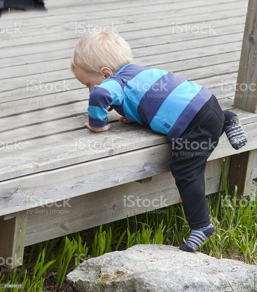 Achievement! Climbing toddler. royalty-free stock photo