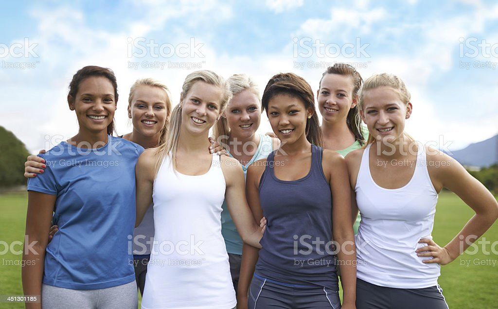 Achieving our fitness goals as a team stock photo