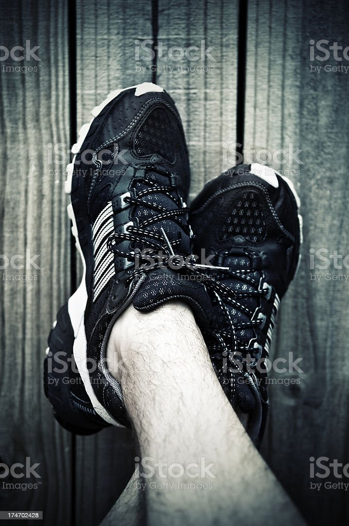 acidify tones for runner resting against wooden background stock photo