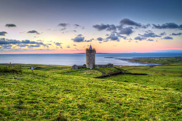 acient tower on the coast of co. clare at sunset - the burren stock pictures, royalty-free photos & images