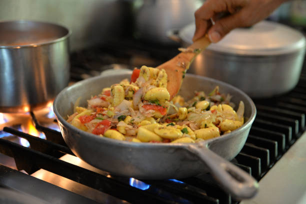 ackee and saltfish - caribbean culture stock pictures, royalty-free photos & images