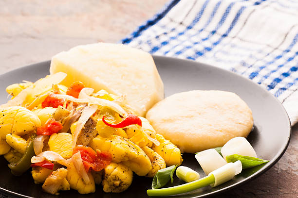 Ackee & Salt Fish This image was taken of a dish of Ackee and Salt Fish served with boiled dumplings and yams. afro caribbean ethnicity stock pictures, royalty-free photos & images