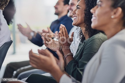 Cropped shot of a group of businesspeople applauding during a seminar in the conference room