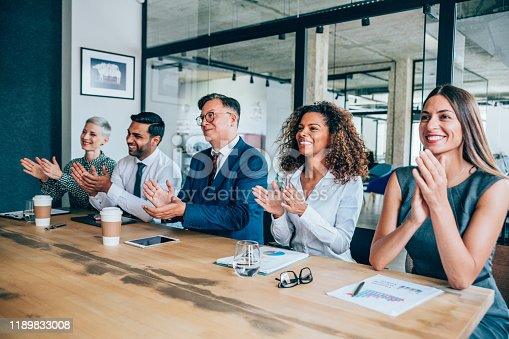 505413934 istock photo Acknowledging a colleague's achievement 1189833008