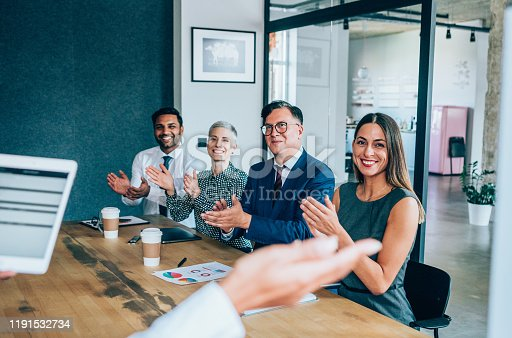 600073884 istock photo Acknowledging a colleague's achievement 1191532734