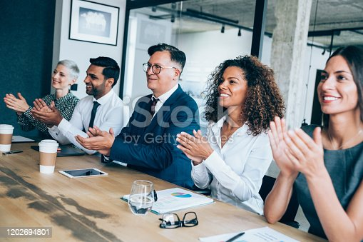 600073884 istock photo Acknowledging a colleague's achievement 1202694801