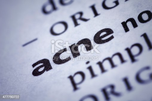 Acne: Dictionary Close-up. Acne is a long-term skin condition characterized by areas of blackheads, whiteheads, pimples, greasy skin, and possibly scarring. Selective focus and Canon EOS 5D Mark II with MP-E 65mm macro lens.