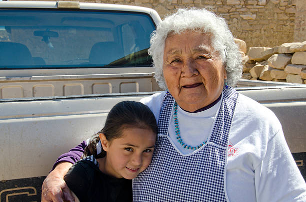 Acoma Grandmother and Granddaughter stock photo