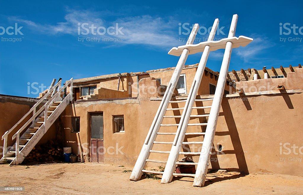 Acoma Pueblo Street with Adobe Houses and Ceremonial Kiva Ladders stock photo