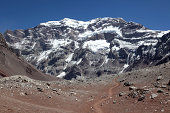 Hiking trail in directions to the Aconcagua Mountain Summit, Argentina. The trail is located in a rocky landscape.