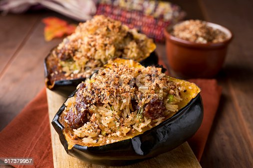Roasted Acorn Squash Stuffed With Rice and Sausage.