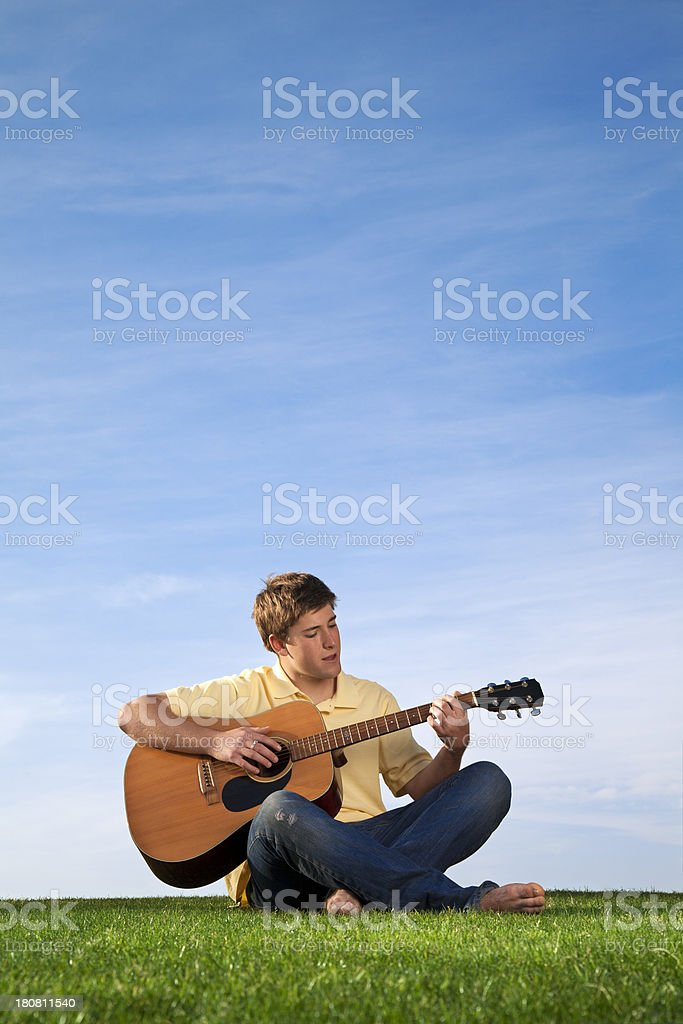 Acoustic Guitar Being Played by a Teenager stock photo
