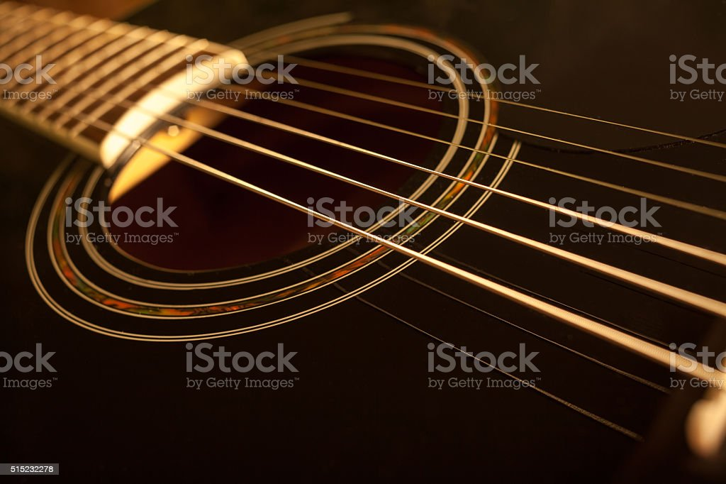 acoustic guitar close-up shot stock photo