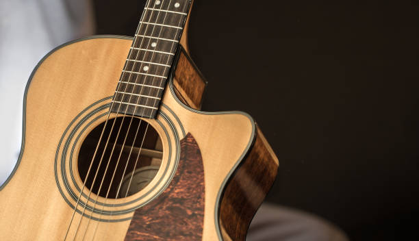 acoustic guitar closeup with copy space stock photo