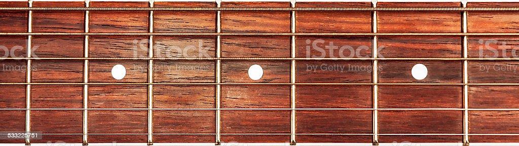 Acoustic guitar fretboard background stock photo