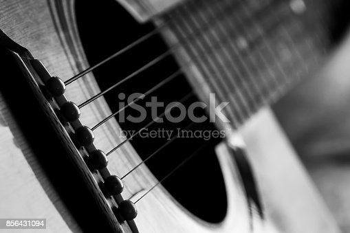 istock Acoustic guitar in black and white 856431094