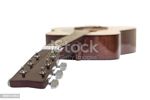 1014432572istockphoto Acoustic guitar isolated on a white background 509244554