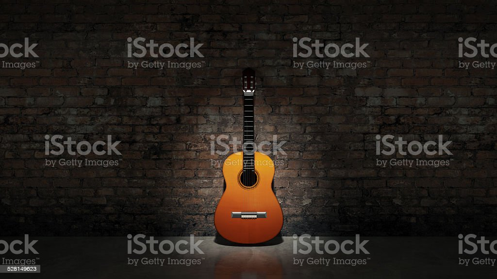 Acoustic guitar leaning on grungy wall stock photo