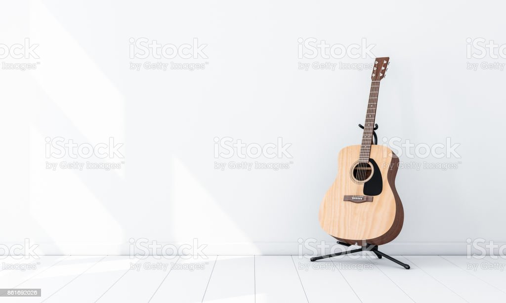Acoustic Guitar Mockup on Stand in white empty room stock photo