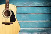 Acoustic guitar on blue vintage wooden wall