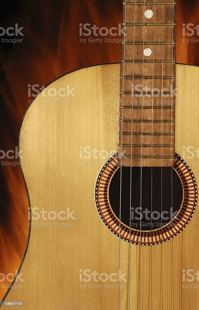 Acoustic guitar on fire background stock photo